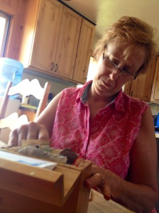 Mom shuffling through a recipe box.